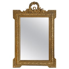Louis XVI Style Wood Gilded Mirror with Wreath Decorative Top and Carved Frame