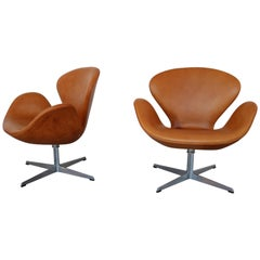 Swan Chairs in Cognac Leather by Arne Jacobsen for Fritz Hansen, 1969 Set of Two