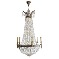 French Regency Style Cut Crystal Bronze Twelve-Light Chandelier