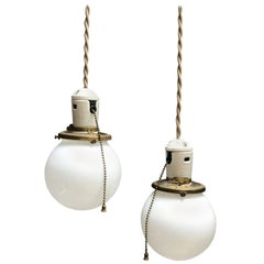 Pair of Petite Industrial Milk Glass and Porcelain Globe Pendant Lights