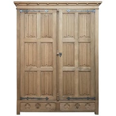 19th Century Rustic Stripped Oak Gothic Armoire