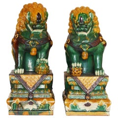 Pair of Green and Gold Chinese Sancai Glazed Foo Dogs