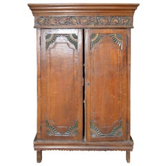 Vintage Indonesian Armoire with Polychrome Accents and Medallion Carved Frieze