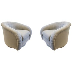 Pair of Swivel Lounge Chairs in the Manner of Milo Baughman
