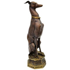 Patinated Bronze Figural Sculpture of a Sitting Dog
