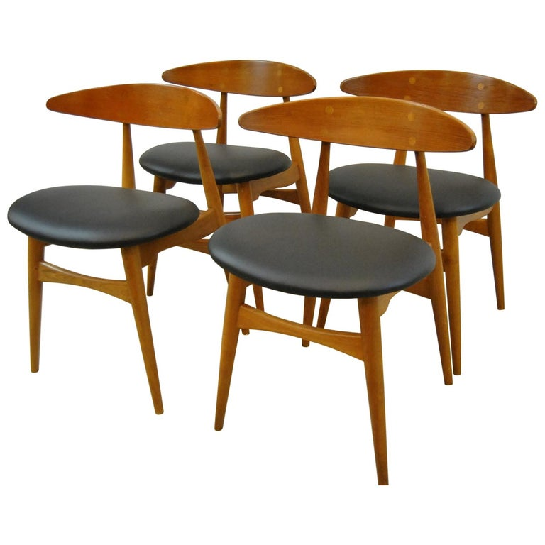 Mid-Century Modern Set of Four Hans Wegner Teak Dining Chairs, Model CH33