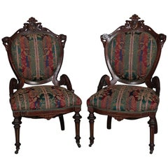Pair of Renaissance Revival Carved Walnut Upholstered Parlor Side Chairs
