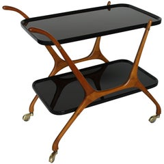 1950s Black Opaline Glass and Walnut Structure Italian Bar Cart