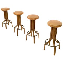 Set of four Camel Color Leather & Walnut Plywood Revolving Stools, Italy, 1970s