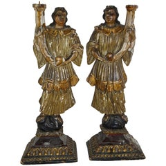 18th Century Pair of Carved Gilt and Paint Italian Figures Holding Candles
