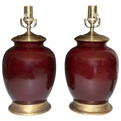 Pair of Asian Oxblood Porcelain Lamps