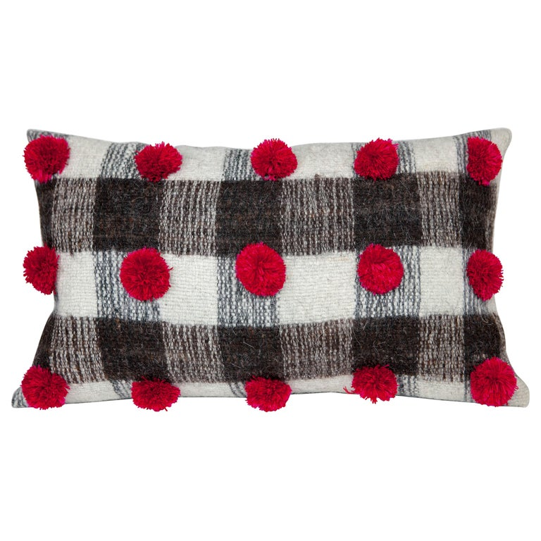 Handwoven wool throw pillow with pom poms, 2018