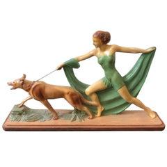 Art Deco British Polychrome Ceramic Girl with Dog Statue, circa 1930