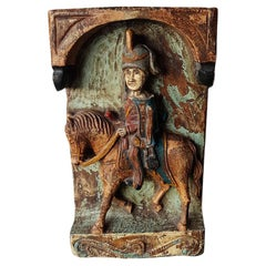 Carved Wooden Plaque of a Soldier on a Horse