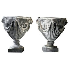 Pair of 20th Century Neoclassical Revival Lead Garden Urns