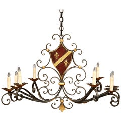 Early 20th Century French Eight-Light Iron Chandelier with Center Painted Shield
