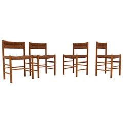 """Four """"Dordogne"""" Chairs by Charlotte Perriand for Robert Sentou"""
