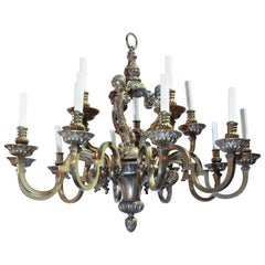 Fifteen-Light Neoclassical Bronze Chandelier with an Antique Gold Finish