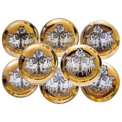 Piero Fornasetti Set of Eight Coasters of Chariots on a Gold Ground, 1960s