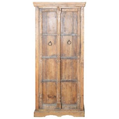Indian Vintage Wooden Armoire with Metal Braces and Hand-Carved Decor