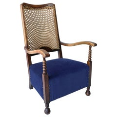 Classic Highback Lounge Chair with Blue Seat and Wooven Rattan Back