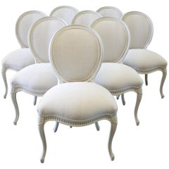 Set of Eight Painted and Upholstered Louis XV Style Dining Chairs