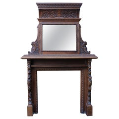 Early 20th Century Heavily Carved Oak Fire Surround with Mirrored over Mantel