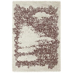 Brabbu Yupik Hand-Tufted Dyed Wool Rug in White and Burgundy