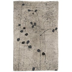 Brabbu Poppy Hand-Knotted Dyed Wool Rug in Sand with Floral Pattern