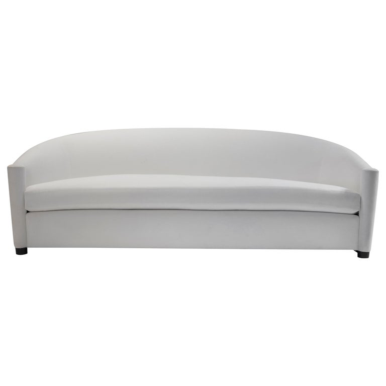 Curved Sofa with Scroll Arms and Loose Seat Cushion with Wrap around Wood Legs For Sale