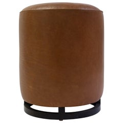 Round Leather Pouf on Dark Mahogany Base with Circular Detail at Seat