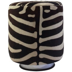 Round Pouf on Steel Metal Base with Faux Animal Skin and Self Welt at the Seat