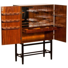 1968, Mahogany and Brass Dry Bar Cabinet High Black Skinny Legs by Förenade