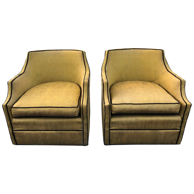 Pair of Silk Hollywood Regency Swivel Chairs