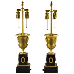 Pair of Gilt Bronze and Black Marble Lamps, circa 1840