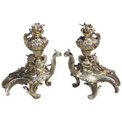 Pair of French Brass Flame Urn Finial and Winged Cherub Floral Chenets, C. 1820
