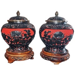 20th Century Pair of Chinese Cinnabar and Enamel Lidded Urns on Stand