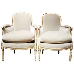 Pair of French Louis XVI Bergères with a Painted and Parcel Gilded Finish