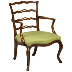 George III Mahogany Open Armchair with a Decorative Serpentine Ladder Back