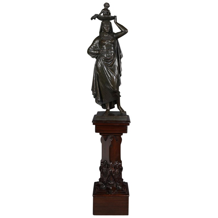 'An Egyptian Woman With Child', A Patinated Bronze Figural Group, Dated 1863