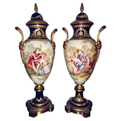 Pair of Sevres Vases Signed with Bronze Mounts and Masked Handled Sides
