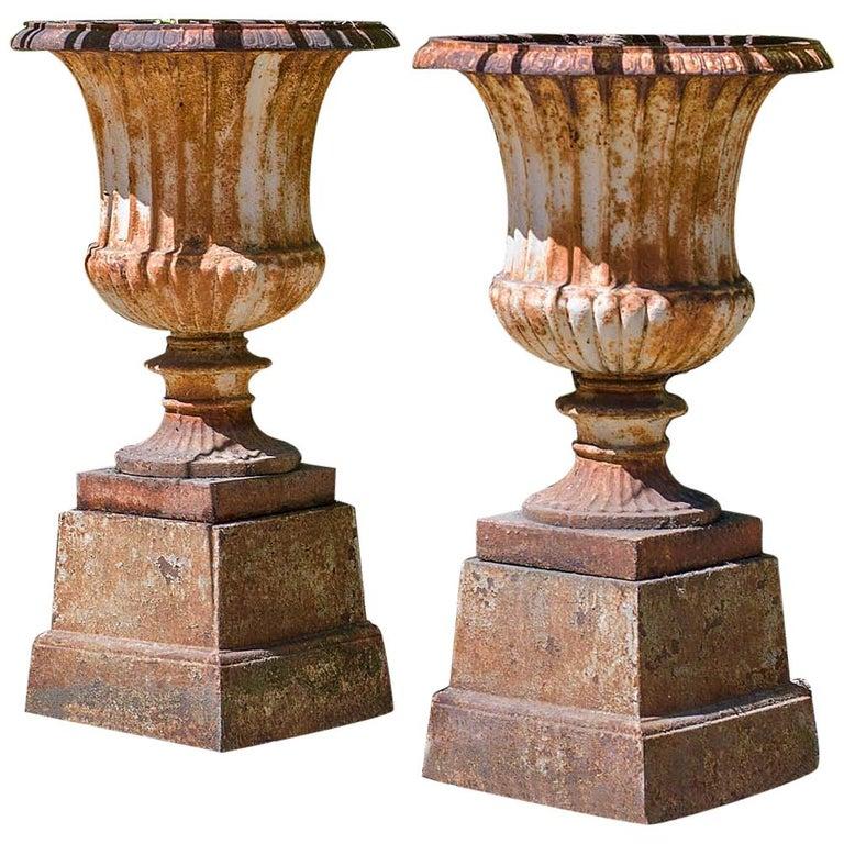 Pair of 19th Century Cast Iron Campan Garden Urns
