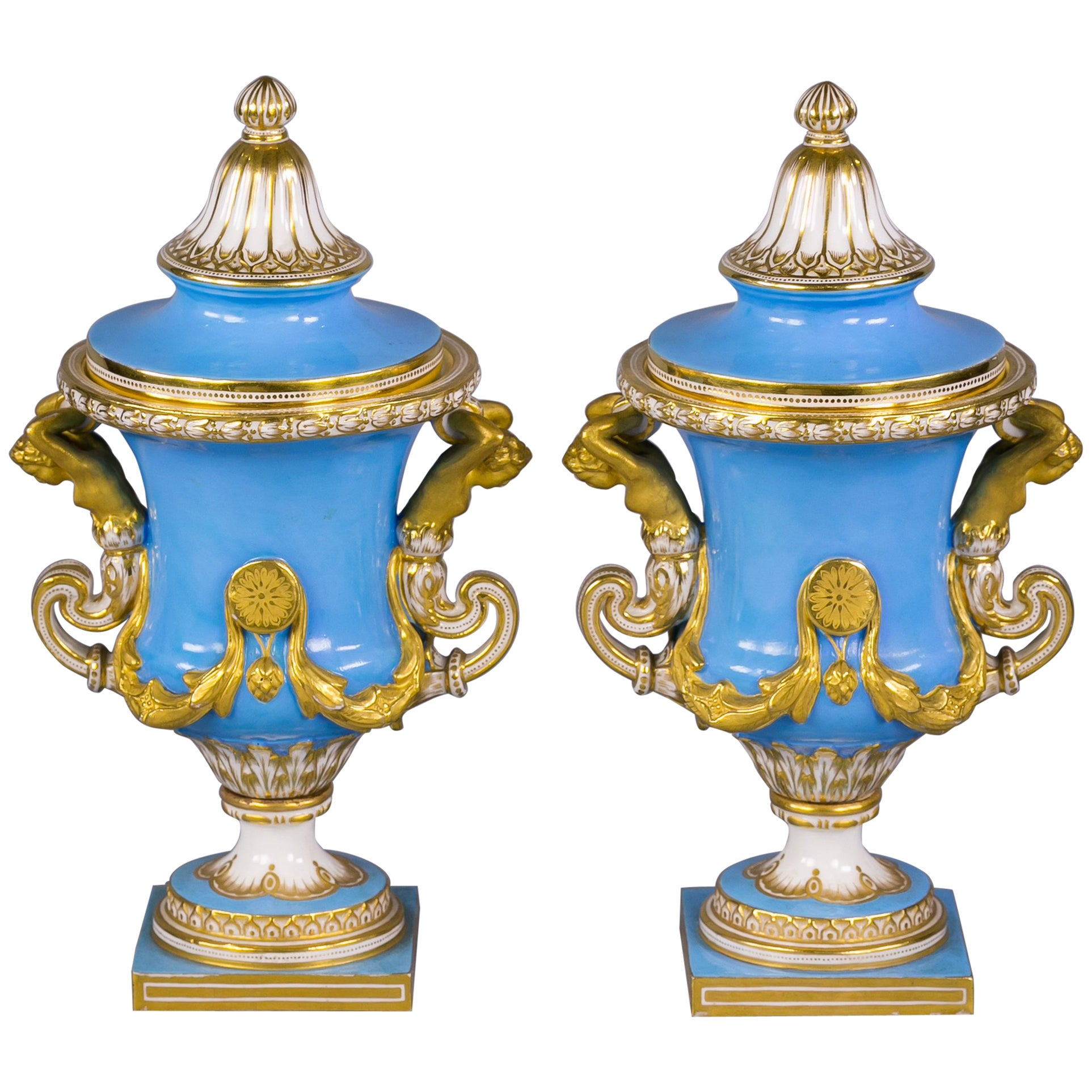Pair of French Porcelain Gilt and Sky Blue Covered Urns, Sevres, circa 1860