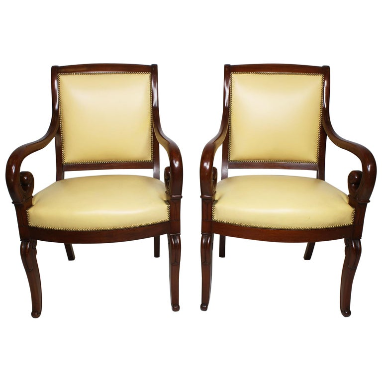 Pair of French Early 20th Century Regency Style Mahogany Carved Armchairs