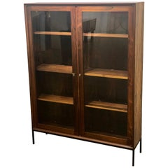 Danish Modern Rosewood Glass Bookcase by Arne Hovmand Olsen on Solid Iron Base