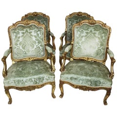 Set of Four French 19th Century Louis XV Rococo Style Gilt Wood Carved Armchairs