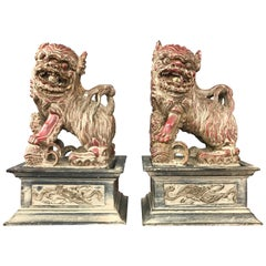 Chinese Lacquered and Giltwood Guardian Lions on Pedestals, a Pair