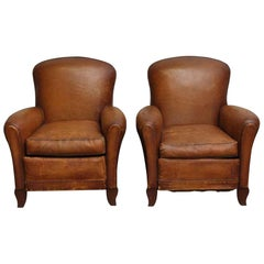 1970s French Pair of Leather Club Chairs with a Studded Back