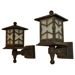 Rare Pair of 1920s Cast Iron Outdoor Sconces
