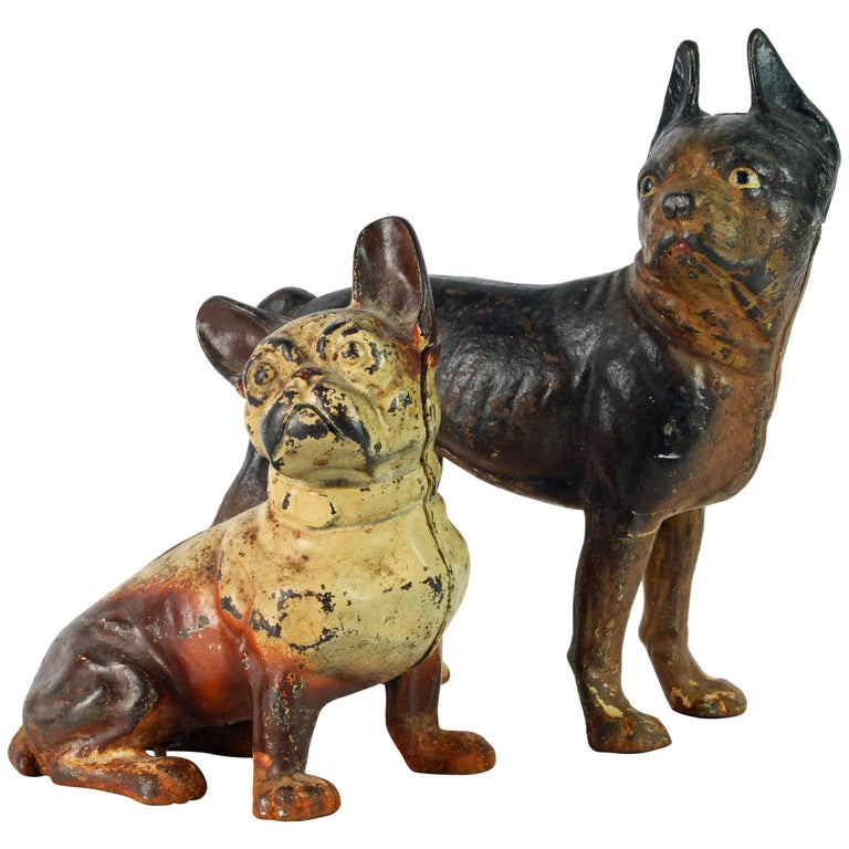 Two Charming Early 20th Century Painted Cast Iron Door Stop Dogs For Sale